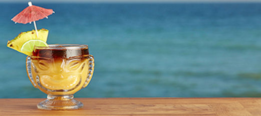Tropical cocktail with beach in background