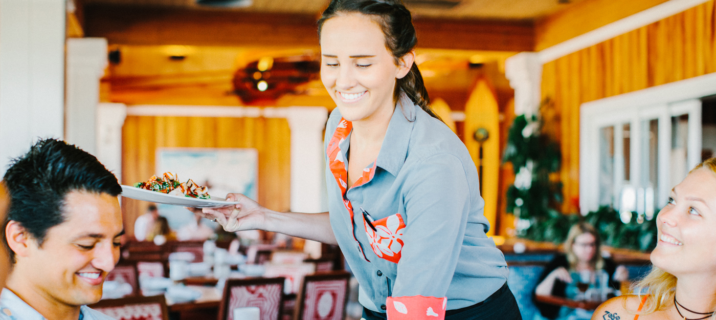 A waitress delivering a meal